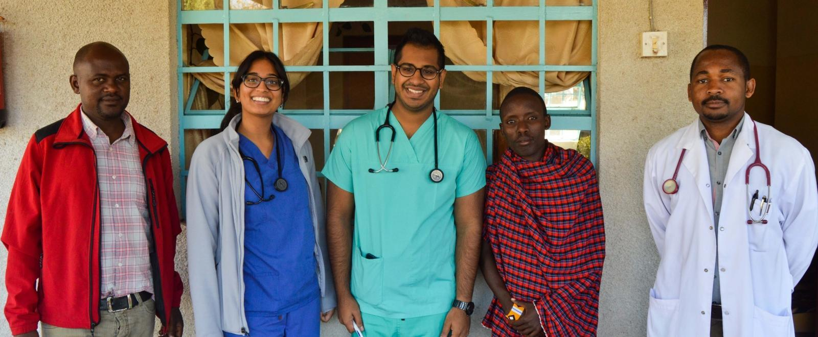 Local medical staff with a group of Projects Abroad Medicine interns doing work experience placements in Tanzania.
